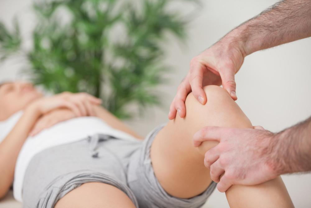 Woman getting physical therapy for her knee injury.